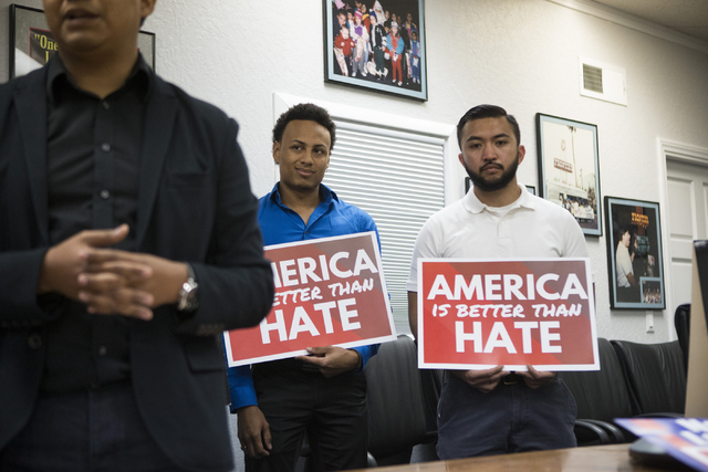 Nathaniel Phillips, left, and A.J. Buhay, field action organizers for the Progressive Leadership Alliance of Nevada, participate during a press conference on immigration at the Culinary Workers Un ...