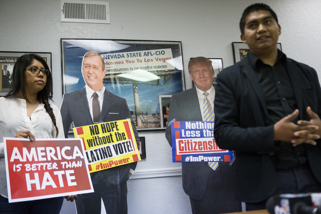 Erika Castro, left, organizer for the Progressive Leadership Alliance of Nevada, participates during a press conference on immigration at the Culinary Workers Union Local 226 on Tuesday, July 12,  ...
