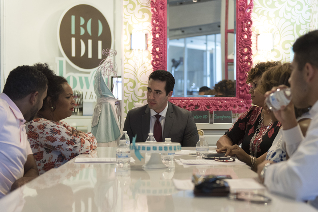 Democratic nominee for the 4th Congressional District Ruben Kihuen, center, speaks with local entrepreneurs at Blowout Dollhouse at Tivoli Village in Las Vegas Thursday, July 7, 2016. (Jason Oguln ...