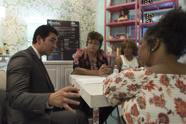 Democratic nominee for the 4th Congressional District Ruben Kihuen, left, speaks with local entrepreneurs at Blowout Dollhouse at Tivoli Village in Las Vegas Thursday, July 7, 2016. (Jason Ogulnik ...