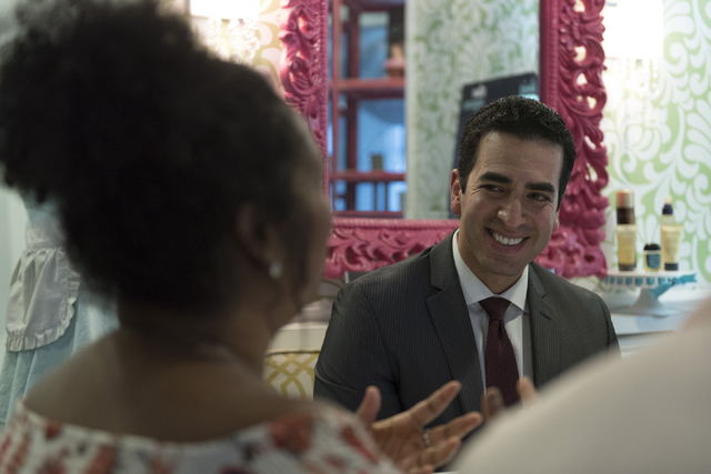 Democratic nominee for the 4th Congressional District Ruben Kihuen, right, speaks with local entrepreneurs at Blowout Dollhouse at Tivoli Village in Las Vegas Thursday, July 7, 2016. (Jason Ogulni ...