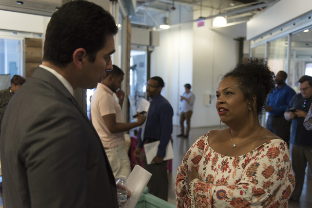 Latoya Holman, owner of Blowout Dollhouse, right, speaks with Democratic nominee for the 4th Congressional District Ruben Kihuen .(Jason Ogulnik/Las Vegas Review-Journal)