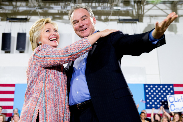 Hillary Clinton, accompanied by Sen. Tim Kaine, D-Va., speaks at a rally at Northern Virginia Community College in Annandale, Va., on Thursday, July 14, 2016. (Andrew Harnik/The Associated Press)