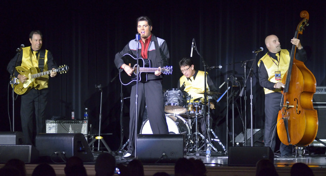 Cody Ray Slaughter, second from left, performs as Elvis with, from left, Kenne Cramer, David Fontana and Wade Bernard during ҉mages of the King Las VegasӠat Samճ Town Live in the Samճ Town hot ...