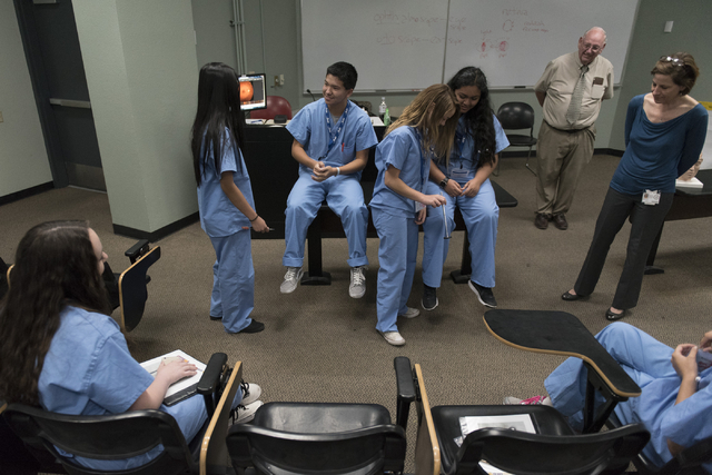 Students conduct a patellar reflex examination during CampMed at UNLV Friday, July 22, 2016. The program is designed to simulate medical career opportunities for students entering ninth grade who  ...