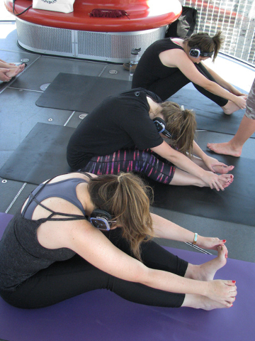 Paricipants take a Silent Savasana class on the High Roller at the Linq June 22. F. Andrew Taylor/View