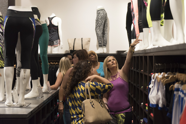 A Fabletics employee, right, assists customers during a preview event for the active wear clothing store at Downtown Summerlin in Las Vegas Thursday, July 21, 2016. Jason Ogulnik/Las Vegas Review- ...