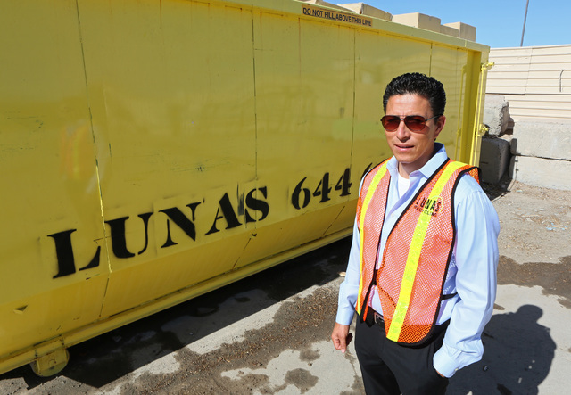 Norberto Madrigal, co-owner of Lunas Recycling, stands near a 40 cubic yard dumpster at Lunas Recycling Monday, July 18, 2016, in Las Vegas. The family-owned waste management facility is located a ...