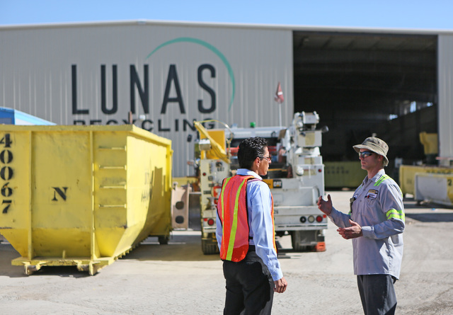 Norberto Madrigal, co-owner of Lunas Recycling, left, speaks with Cashman Cat field service technician, Jason Bateman, at Lunas Recycling Monday, July 18, 2016, in Las Vegas. The family-owned wast ...