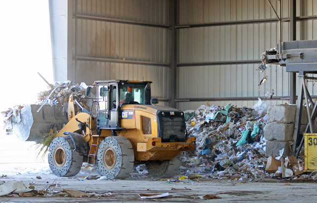 A worker uses a front end loader in the materials recovering facility at Lunas Recycling Monday, July 18, 2016, in Las Vegas. The family-owned waste management facility is located at 4830 E. Carti ...