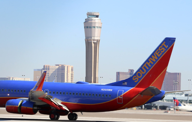 The New Air Traffic Control Tower At Mccarran Airport Is Seen As A Southwest Airlines Jet