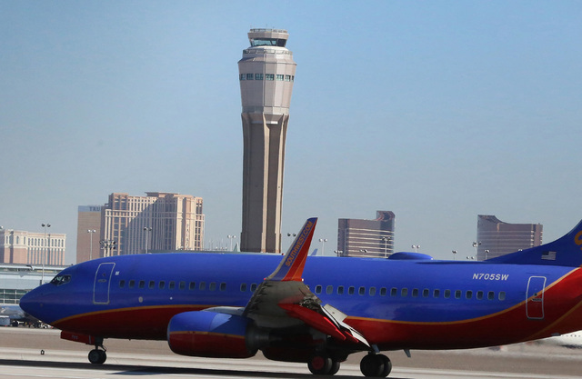The new air traffic control tower at McCarran airport is seen as a Southwest Airlines jet lands on Thursday, July 7, 20176. Bizuayehu Tesfaye/Las Vegas Review-Journal Follow @bizutesfaye