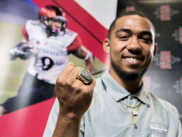 San Diego State running back Donnel Pumphrey, a former Canyon Springs High School student, shows his ring for winning last year's Mountain West Conference championship during the Mountain West Foo ...