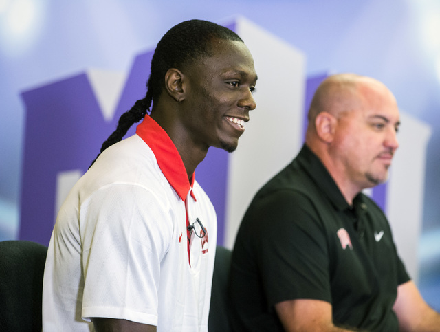 UNLV football wide receiver Devonte Boyd, left, and UNLV football coach Tony Sanchez during a TV interview Wednesday, July 27, 2016, at the Mountain West Football Media Day at Cosmopolitan of Las  ...