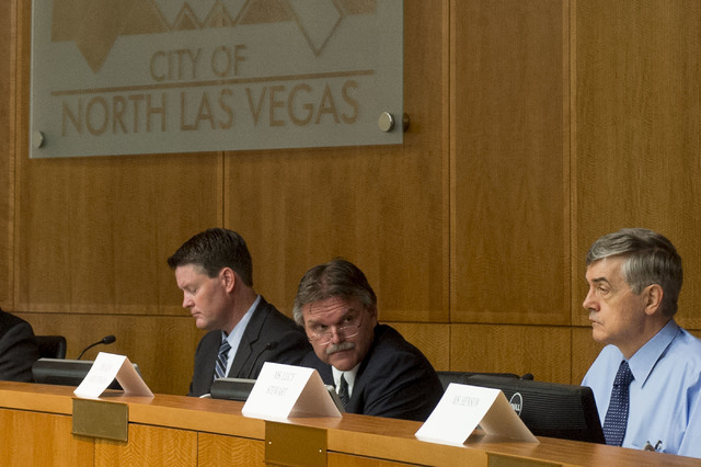 David Jennings, left, Clark County Regional Flood Control District general manager and chief engineer Steve Parrish, center, and Dr. Alan Schlottmann  listen at the House Committee on Natural Reso ...