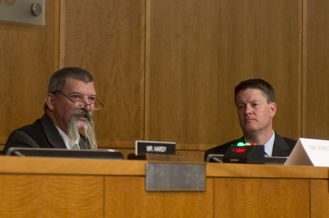 Representing the Bureau of Land Management, John F. Ruhs, left, answers questions as David Jennings, right, during the The House Committee on Natural Resources's special hearing at North Las Vegas ...