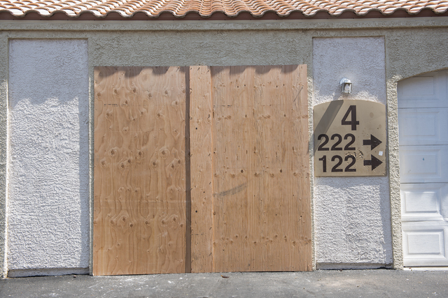 A unit is boarded up at Torrey Pines Condominiums in Las Vegas on Thursday, June 30, 2016. Neighbors said the unit is where three children were found shot dead Wednesday night. Police said Jason D ...