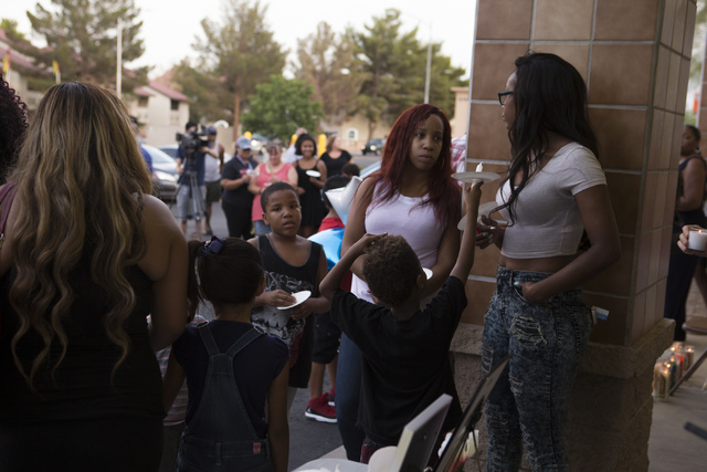Family and community members pay their respects at a candlelight vigil for the victims of a murder-suicide on Friday, July 1, 2016 in Las Vegas. Loren Townsley/ Las Vegas Review-Journal Follow @Lo ...