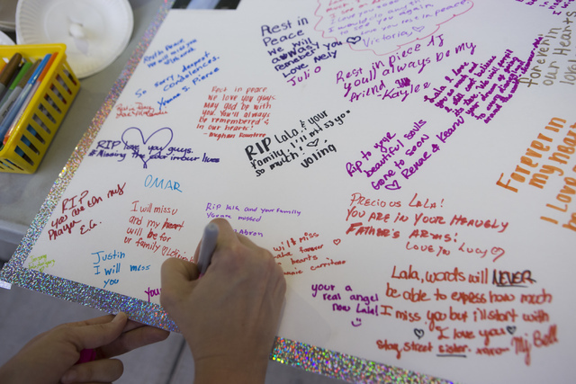 Community members pay their respects to the victims of a murder-suicide by writing messages on Friday, July 1, 2016 in Las Vegas. Loren Townsley/ Las Vegas Review-Journal Follow @LorenTownsley
