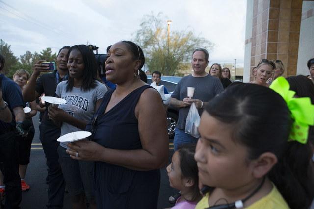 Community members sing during a candlelight vigil for the victims of a murder-suicide on Friday, July 1, 2016 in Las Vegas. Loren Townsley/ Las Vegas Review-Journal Follow @LorenTownsley