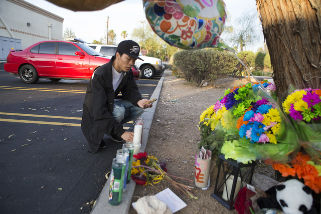 Nick Saelee pays his respects at a candlelight vigil for the victims of a murder-suicide on Friday, July 1, 2016 in Las Vegas. Loren Townsley/ Las Vegas Review-Journal Follow @LorenTownsley
