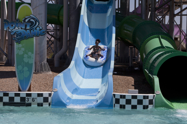 Siblings Ahmyah, 7, and Ahkija, 11, slide down the Point Panic ride at the Cowabunga Bay Water Park in Henderson on Wednesday, June 13, 2016. Loren Townsley/Las Vegas Review-Journal Follow @lorent ...