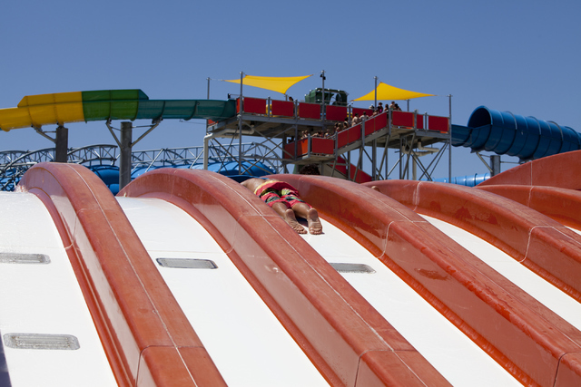 Claudio, 12, goes down a slide at the Cowabunga Bay Water Park in Henderson on Wednesday, June 13, 2016. Loren Townsley/Las Vegas Review-Journal Follow @lorentownsley