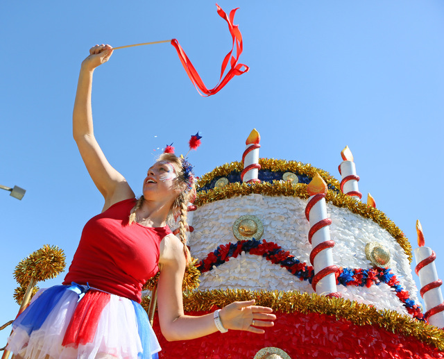 Mikaela Felton dances on a cake float for Station Casinos during the 22nd Annual Summerlin Council Patriotic Parade Monday, July 4, 2016, in Las Vegas. (Ronda Churchill/Las Vegas Review-Journal)