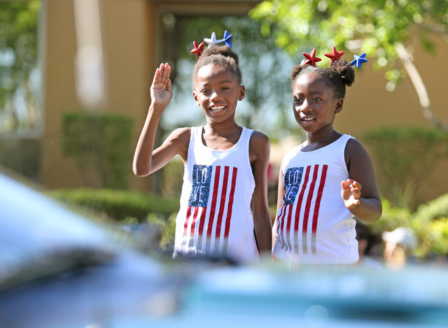 Sisters Erin Bajadali, 8, left, and Lauren, 6, wave at a parade participant during the 22nd Annual Summerlin Council Patriotic Parade Monday, July 4, 2016, in Las Vegas. (Ronda Churchill/Las Vegas ...