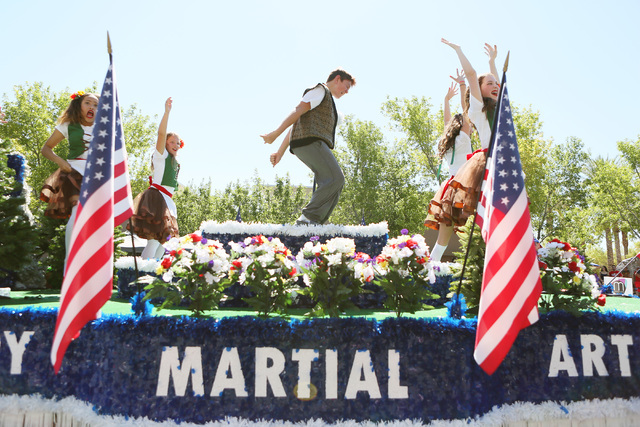 """Dancers perform on a """"Ferris Bueller's Independence Day Off"""" float representing Victory Martial Arts during the 22nd Annual Summerlin Council Patriotic Parade Monday, July 4, 201 ..."""