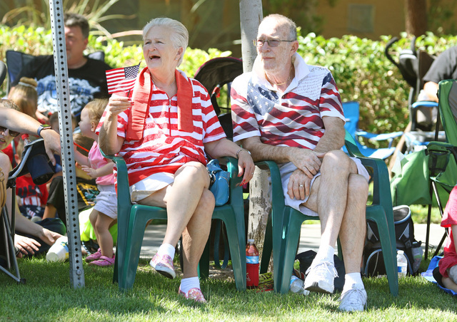 Birthday girl Kathy Gammon, left, sits with her husband Hugh to watch the 22nd Annual Summerlin Council Patriotic Parade Monday, July 4, 2016, in Las Vegas. (Ronda Churchill/Las Vegas Review-Journal)
