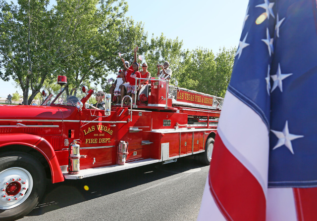 Las Vegas City Councilman Ricki Barlow, back left, rides in a fire truck with family during the 22nd Annual Summerlin Council Patriotic Parade Monday, July 4, 2016, in Las Vegas. (Ronda Churchill/ ...