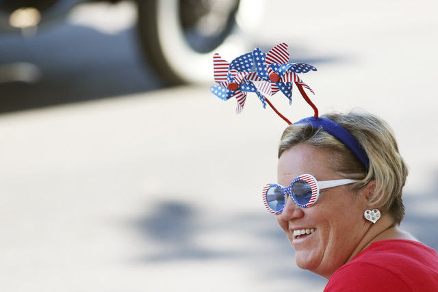 Annie Bush watches the 22nd Annual Summerlin Council Patriotic Parade Monday, July 4, 2016, in Las Vegas. (Ronda Churchill/Las Vegas Review-Journal)