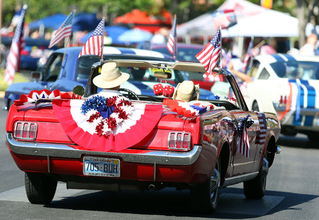 Classic mustangs are shown in a procession during the 22nd Annual Summerlin Council Patriotic Parade Monday, July 4, 2016, in Las Vegas. (Ronda Churchill/Las Vegas Review-Journal)