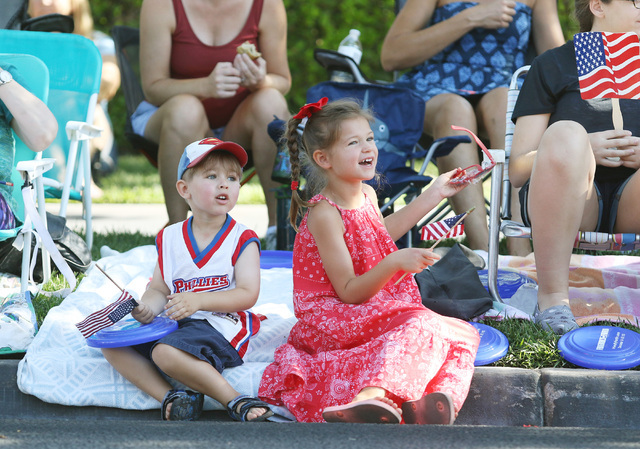 Josiah Goins, 3, left, and Claire Cambria, 5, watch the 22nd Annual Summerlin Council Patriotic Parade Monday, July 4, 2016, in Las Vegas. (Ronda Churchill/Las Vegas Review-Journal)