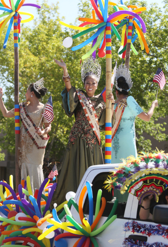 Women wave on the Philippine American Association of Nevada float during the 22nd Annual Summerlin Council Patriotic Parade Monday, July 4, 2016, in Las Vegas. (Ronda Churchill/Las Vegas Review-Jo ...