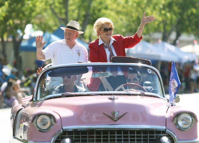 Former Las Vegas Mayor Oscar Goodman, left, and May Carolyn Goodman wave to the crowd during the 22nd Annual Summerlin Council Patriotic Parade Monday, July 4, 2016, in Las Vegas. (Ronda Churchill ...