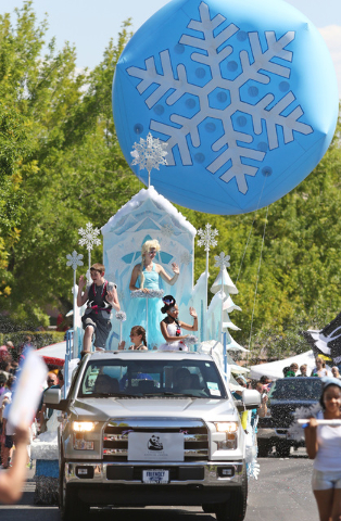 """A """"Frozen Fun"""" float is shown during the 22nd Annual Summerlin Council Patriotic Parade Monday, July 4, 2016, in Las Vegas. (Ronda Churchill/Las Vegas Review-Journal)"""