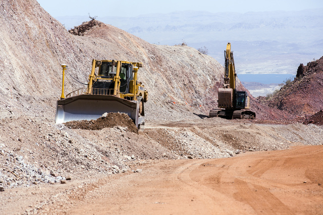 Lake Mead is seen in the background while construction  continues on I-11 Boulder City Bypass  project  on Monday, July 18, 2016. The 12.5 miles of of highway is scheduled to open in late 2018. Je ...