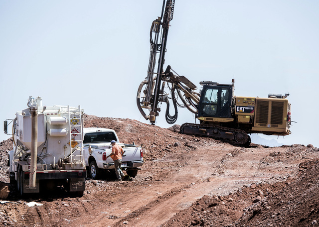 A crew drills on top of a hill at the I-11 Boulder City Bypass construction project on Monday, July 18, 2016. The 12.5 miles of of highway is scheduled to open in late 2018. Jeff Scheid/Las Vegas  ...