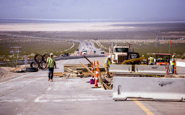 Men work on the  I-11 Boulder City Bypass overpass under construction at U.S. 95 is seen on Monday, July 18, 2016. The 12.5 miles of of highway is scheduled to open in late 2018. Jeff Scheid/Las V ...