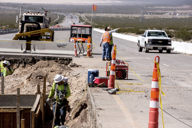Men work on the I-11 Boulder City Bypass overpass under construction at U.S. 95 on Monday, July 18, 2016. The 12.5 miles of of highway is scheduled to open in late 2018. Jeff Scheid/Las Vegas Revi ...