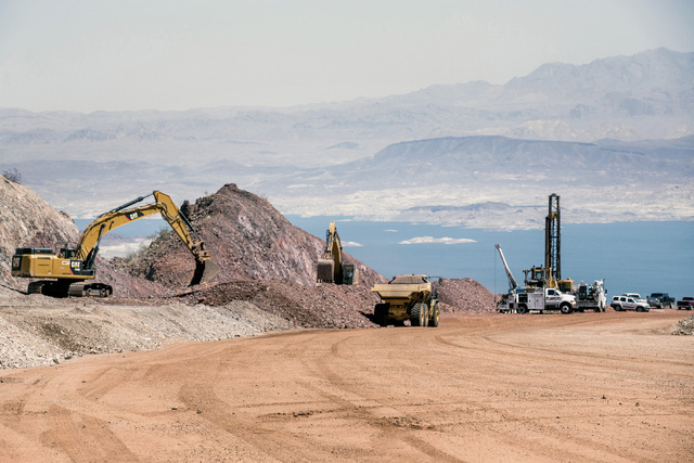 Lake Mead is seen in the background while construction  continues on I-11 Boulder City Bypass construction project  on Monday, July 18, 2016. The 12.5 miles of of highway is scheduled to open in l ...