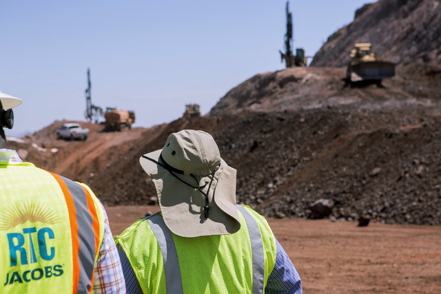 People monitor operations at the I-11 Boulder City Bypass construction project on Monday, July 18, 2016. The 12.5 miles of of highway is scheduled to open in late 2018. Jeff Scheid/Las Vegas Revie ...