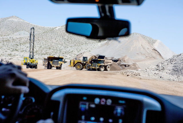 A loader fills trucks at the I-11 Boulder City Bypass construction project on Monday, July 18, 2016. The 12.5 miles of of highway is scheduled to open in late 2018. Jeff Scheid/Las Vegas Review-Jo ...
