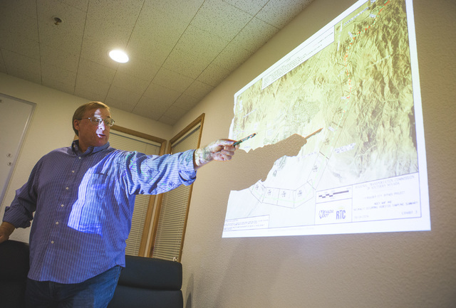 Gary Pons, corporate health and safety director at SCS, discusses asbestos monitoring on the I-11 Boulder City Bypass construction project on Monday, July 18, 2016. The 12.5 miles of of highway is ...
