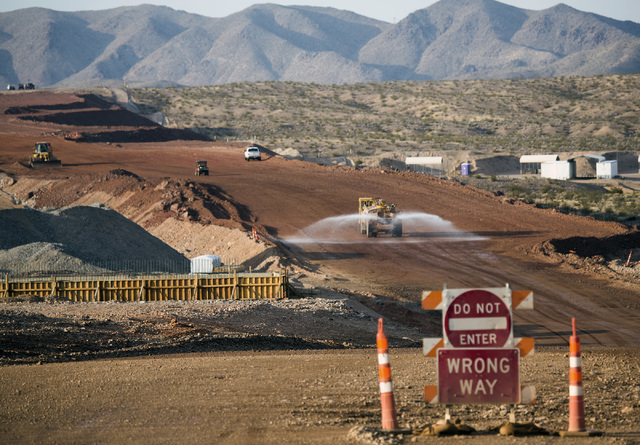 A water tanker sprays water on the under-construction Interstate-11 Boulder City Bypass project on Monday, July 25, 2016. The 12.5-mile freeway is scheduled to open in late 2018.  (Jeff Scheid/Las ...