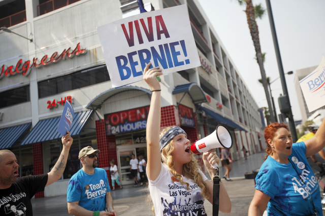Melissa Score leads the March For Bernie USA demonstration at the Fremont Street Experience in downtown Las Vegas on Sunday, July 24, 2016. (Rachel Aston/Las Vegas Review-Journal) Follow @rookie__rae