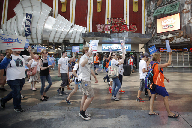 Bernie Sanders supporters walk for the March For Bernie USA demonstration at the Fremont Street Experience in downtown Las Vegas on Sunday, July 24, 2016. (Rachel Aston/Las Vegas Review-Journal) F ...