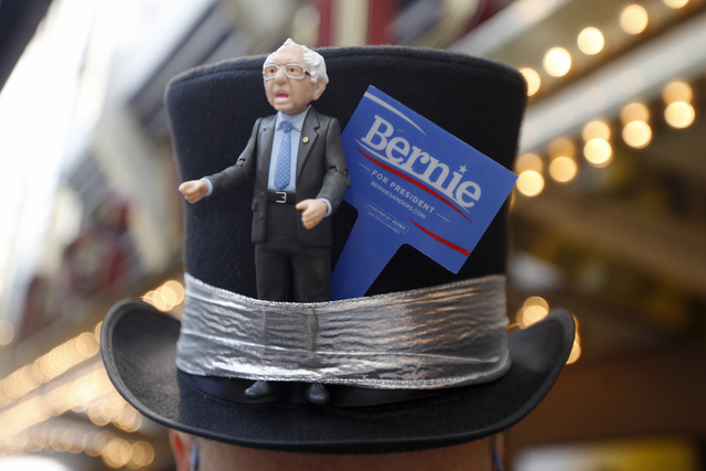 Matthew Gucu shows off his hat at the March For Bernie USA demonstration at the Fremont Street Experience in downtown Las Vegas on Sunday, July 24, 2016. (Rachel Aston/Las Vegas Review-Journal) Fo ...